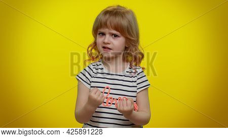 Aggressive Angry Blonde Kid Child 5-6 Years Old In T-shirt Trying To Fight At Camera, Shaking Fist,