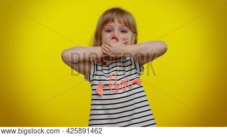 I Will Not Say Anyone. Frightened Little Blonde Teen Kid Child Girl Closing Her Mouth With Hand, Loo