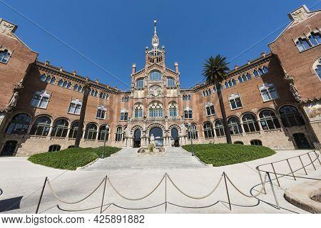 BARCELONA, SPAIN - MARCH 22, 2019: Entrance of the former Hospital of the Holy Cross and Saint Paul (Hospital de Sant Pau) in Barcelona, Catalunya, Spain
