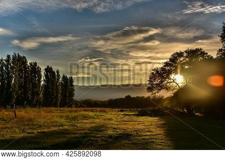 Sunset In A Green Field With A Mountain Background In Amaicha Del Valle, Tucumán, Argentina  Field F