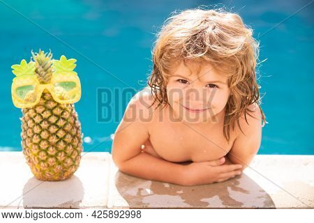 Kids Swimming Pool Concept. Summer Vacation. Relax In Spa Swimming Pool. Children Playing In Pool. S