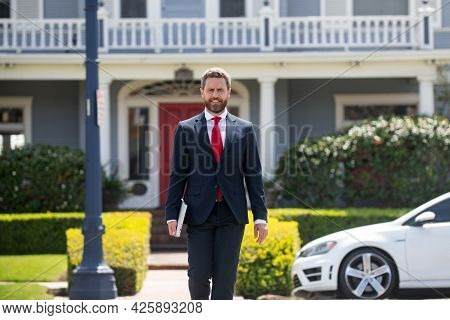 Portrait Of A Confident Male Estate Agent. Businessman Real Estate Agent Or Lawyer Having In Urban C