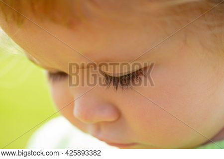 Portrait Of A Cute Baby. Close Up Caucasian Kids Face. Closeup Head Of Funny Kid.