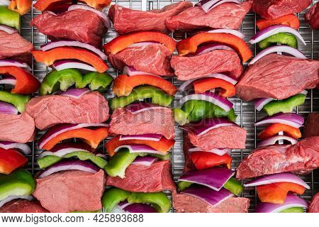 Photograph Of Freshly Prepared Steak Kabobs With Red Onions And Bell Peppers Getting Ready For The G
