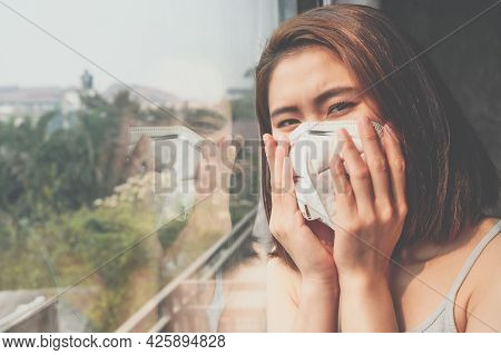 Portrait Of Asian Woman Wearing A Dust Mask For Prevent Pm2.5 Bad Air Pollution Before Going Outside