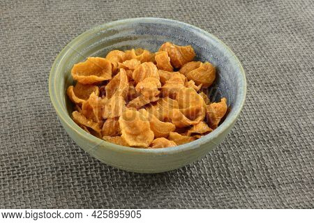 Conch Shell Shaped Crunchy Snack Made From Peanuts, Coconut Cream And Sesame Seeds In Ceramic Snack