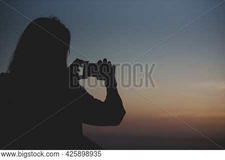 Woman Take A Picture In The Island Of Formentera In The Balearic Islands In Spain At Sunset