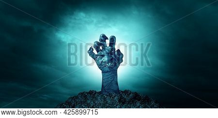 Creepy Zombie Hand Face Reaching To Grab Something Or Someone As A Monster Rising Out Of The Ground