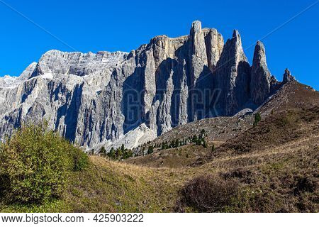 The Dolomites. Erosion has created landscapes with bare cliffs, vertical rocks and long valleys. Europe. The Eastern Alps. The mountains are surrounded by coniferous forests.