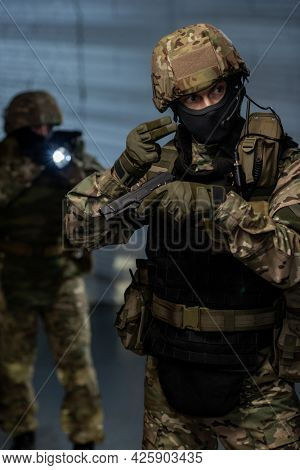 Men in military outfit going to captivate terrorists or criminals