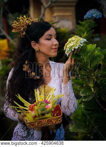 Caucasian Woman Preparing For Balinese Ceremony. Beautiful Woman Wearing Traditional Religious Cloth