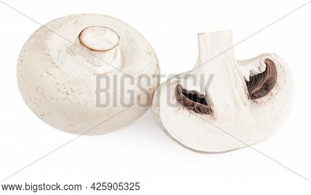 Fresh Champignon Mushrooms Isolated On White Background. Whole And Sliced Champignons