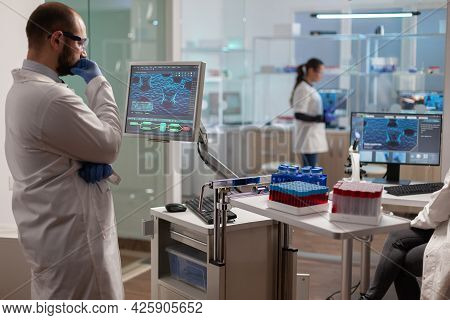 Medical Researcher In Scientific Laboratory Analyzing Dna Sample. Chemical Scientis Analyzing Vaccin