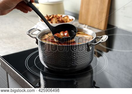Woman Making Delicious Compot In Pot On Stove, Closeup