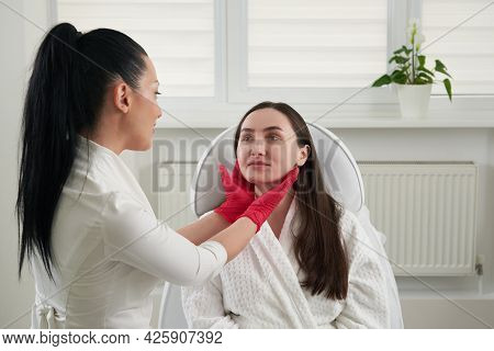 Cosmetologist Checking Face Skin Condition During Skin Examination In Beauty Salon. Professional Ski