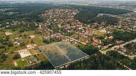 Marked Vacant Land For Construction And Sale. The Concept Of Selling Land And Residential Real Estat