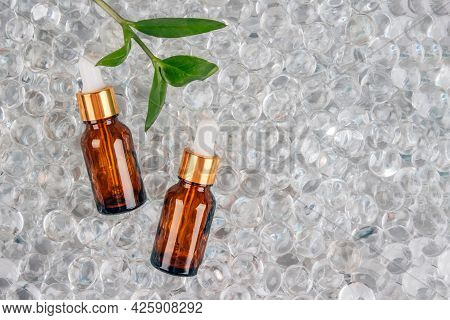 Mockup Image Of Two Dropper Bottles With Natural Organic Herbal Cosmetic Oil On Light Background Of