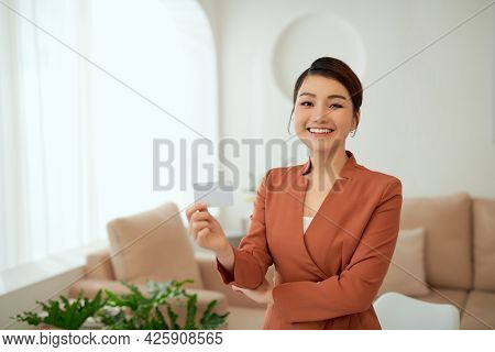 Business Woman Holding And Showing White Business Card Or Blank Card Name In Hands.