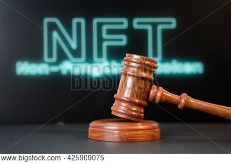Concept Showing Of Nft Or Non Fungible Token Auction Or Bidding Using Auction Hammer With Nft Writte