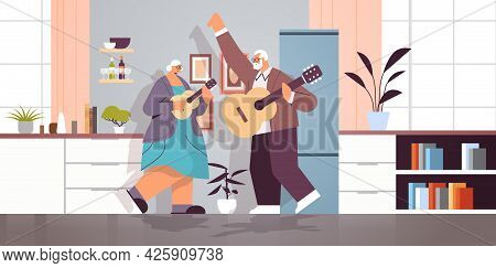 Senior Couple Playing Guitar Grandparents Having Fun Active Old Age Concept Home Kitchen Interior