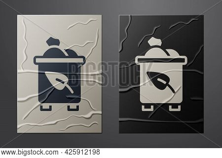 White Recycle Bin With Recycle Symbol Icon Isolated On Crumpled Paper Background. Trash Can Icon. Ga