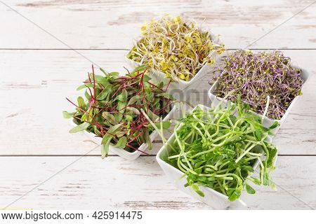 Mix Of Various Sprouts On Wooden Background. Sprouted Seeds. Healthy Eating, Detoxification.