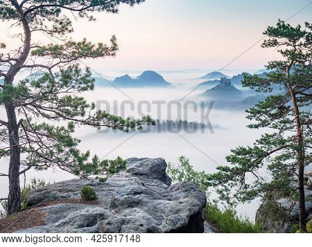 Beautiful Morning View Saxony Switzerland. Sandstone Peaks And Hills Increased From Foggy Background