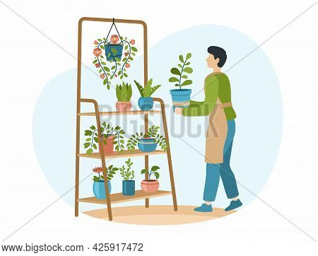 Home Gardening. Male Character Take Care To Houseplants. Man In Apron Carefully Puts Flower In Pot O