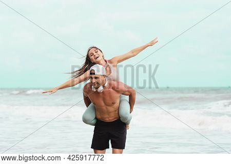 Happy Couple In Sport Wear On Vacation At Tropical City. Man And Woman Lovers Enjoy Each Other In Th