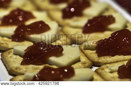 Party Platter With Manchego Cheese And Tomato Jelly Over Crackers As An Appetizer - Selective Focus-