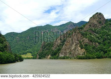 Landscape of Olt Valley with Olt river and Cozia Mountains in Romania