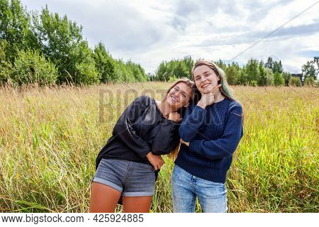 Summer Holidays Vacation Happy People Concept. Group Of Two Girl Friends Dancing Hugging And Having