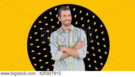 Composition of male fashion designer smiling on yellow background. fashion design, fashion show and clothing concept digital image.