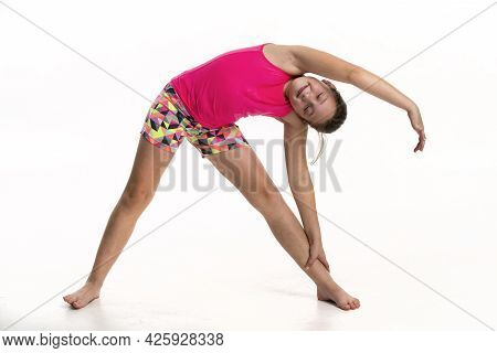 A Tween Girl Doing A Side Stretch.