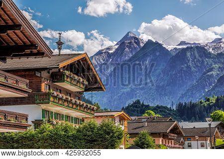 Kaprun Village With Typical Pension Against Kitzsteinhorn Glacier In Salcburg Region, Austrian Alps