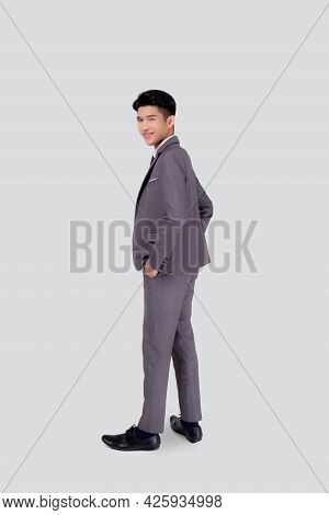 Rear View Of Young Asian Businessman In Suit Hand In Pocket With Confident Isolated On White Backgro