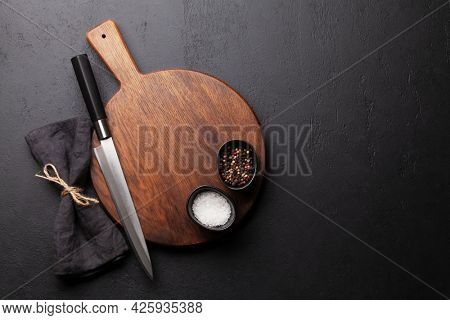 Blank cutting board, knife and spices. Template for your cooking recipe