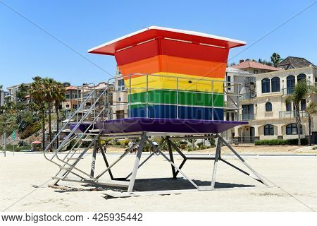 LONG BEACH, CALIF - 5 JUL 2021: Pride Tower, at Alamitos Beach. The rainbow-colored lifeguard tower supports the LGBTQ community replacing an earlier tower destroyed in an arson fire.