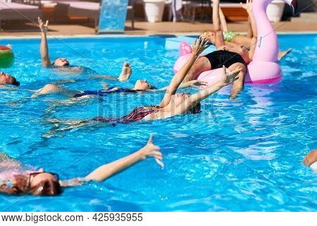 Multiracial Group Of Friends Chilling In Private Villa Swimming Pool. Happy Young People In Swimwear
