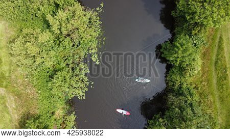 Aerial View Of Two Paddle Boarders On A River