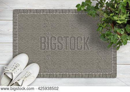Door Mat Mockup. Mat On Wooden Floor, Ivy Flower In Pot And Shoes. Top View. Mockup For Text Or Desi
