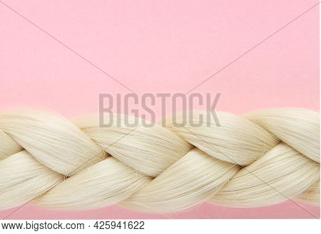 Beautiful White Pigtail. The Braid Is Braided By A Blonde In An Empty Frame On A Pink Background. Th
