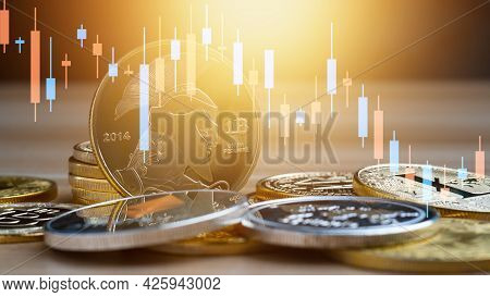 Business Bitcoin With Graph Chart On Table, Cryptocurrency