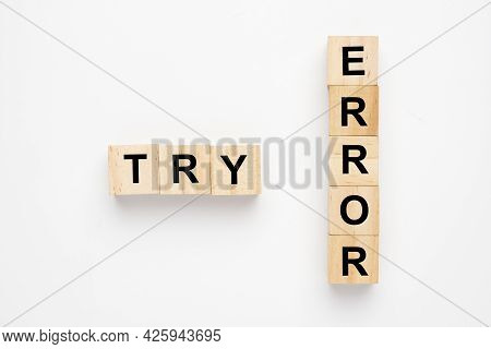 A Wooden Block Arrange The Word Try Error. Try And Error Concept