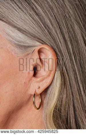 Senior woman wearing hoop earrings