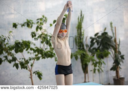 Boy In A Swimming Cap In The Sports Pool.