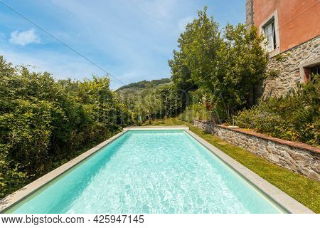 Exterior of Italian villa in Tuscany with swimming pool. Day of great sunshine