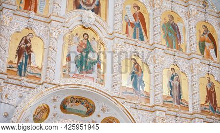 The Iconostasis Inside An Orthodox Church. Video. Bottom View Of The Icons With The Faces Of The Sai