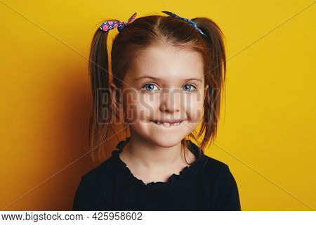 Funny Adorable Kid Showing The First Milk Tooth. Change Teeth Concept. Cute Little Girl With Ponytai