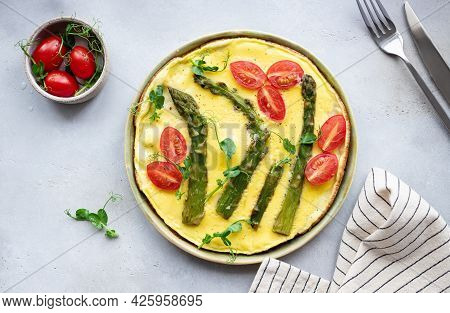 Asparagus And Tomatoes Frittata With Microgreens On Gray Table. Italian Cuisine Concept. Top View